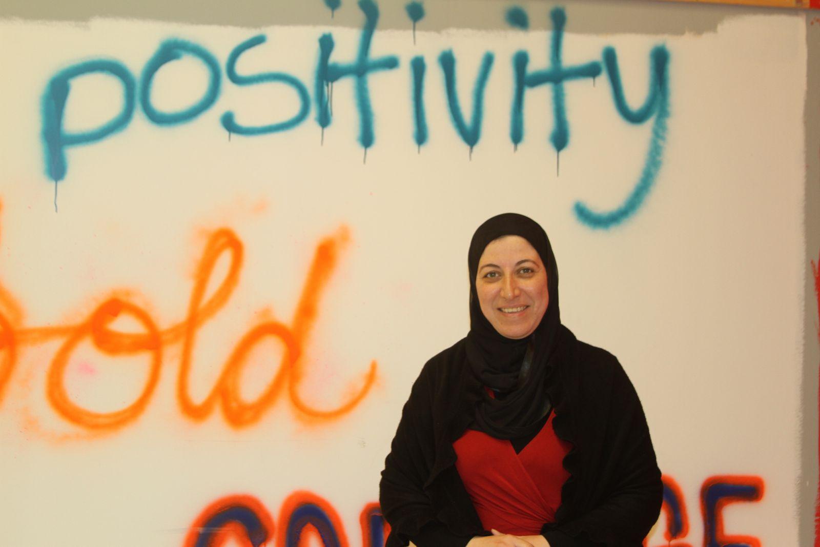 Dalia Abdellatif volunteers at Edmonton Evacuee Reception Centre.